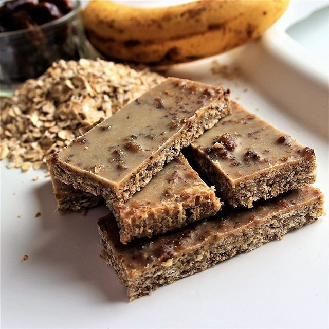 Home-made banana & date cereal bars with a melt-in-the-mouth tahini and cacao butter topping. Easy for lunch boxes. Just the right amount of naughty and healthy to keep you and your little ones away from commercial snack foods! #noprocessedfood #refinedsugarfree #wholefoodbaby #wholefoods #sugarfreefamily #healthysnacksforkids