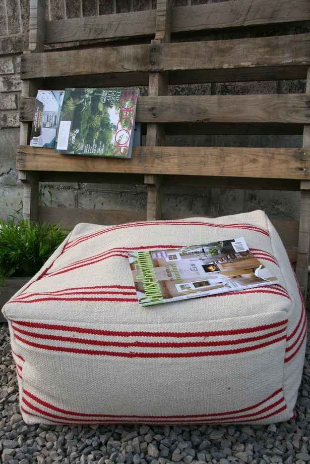Floor poufs are awesome, but they tend to be super expensive: save some money and make your own using a floor mat.