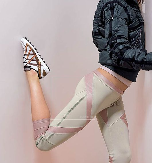 Adidas by Stella McCartney | Black bomber jacket, striped shoes and cream colored tights with pink zigzag pattern down the leg.