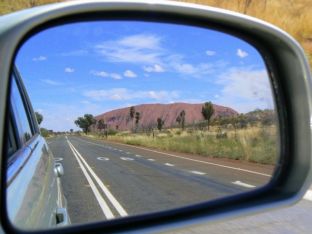 The Outback ahead of you and Uluru behind you - not a bad place to be.