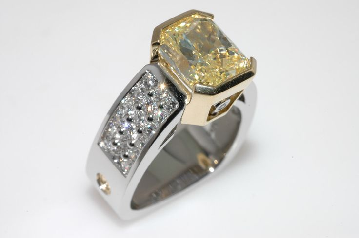 4.41ct Natural Fancy Yellow Radiant Cut diamond set in Coffin & Trout Paragon collection.