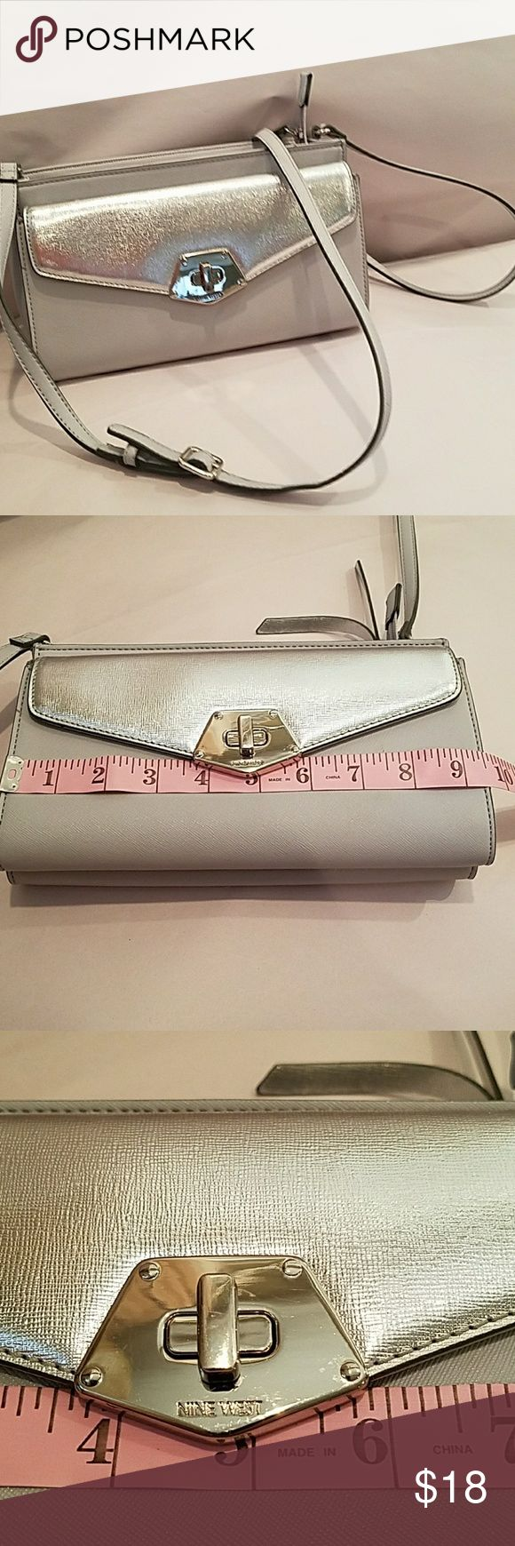 NWOT 9 West crossbody bag Light gray bag with silver flap and silver trim. 24 inch drop. Never used. No scratches apparent on the metal and no fraying on the handle. There is an unbranded dust jacket in the front pocket. Tiny spot on the back  priced accordingly. Bundle the save 20%. Nine West Bags Crossbody Bags
