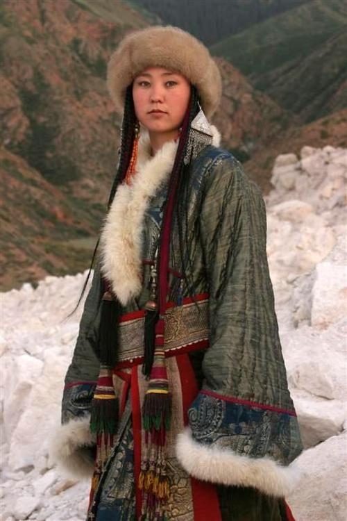 Nomadic Kirghiz woman in traditional dress, Kirghistan, Central Asia. Uzbek suzani textiles (central asian ethnic textile collector)