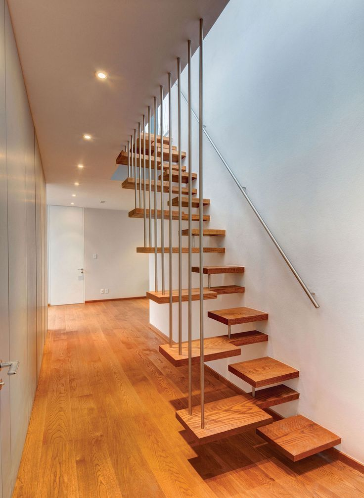 Floating wooden staircase in Valna House, Mexico City, by JSA Artchitects
