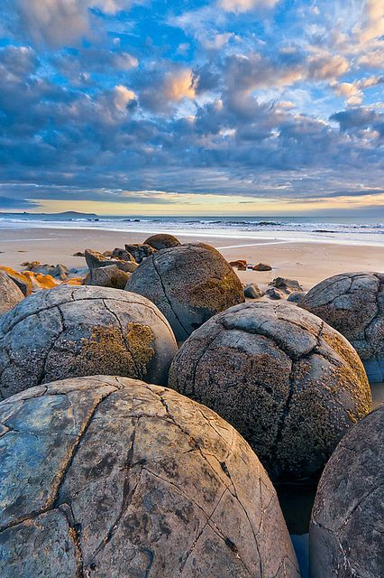 The Moeraki Boulders are unusually large and spherical boulders lying along a stretch of Koekohe Beach in New Zealand