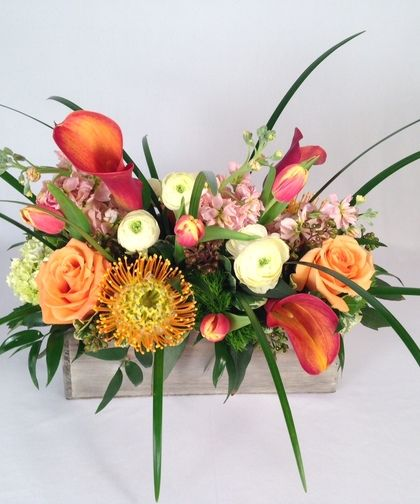 Perfect for your modern #Thanksgiving table. Mix of premium flowers in a wonderful rustic wooden planter.
