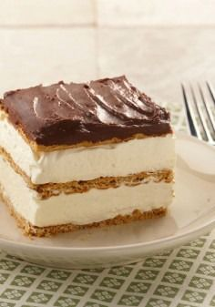 """Graham Cracker Eclair """"Cake"""" – This delectably airy dessert recipe includes layers of graham cracker that become cake-like and lusciously soft from the pudding."""