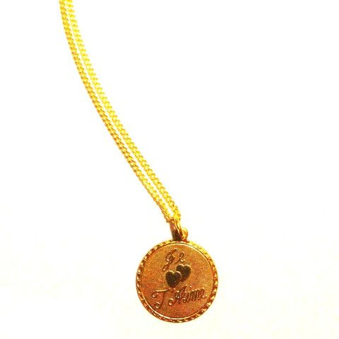 'Je T'aime' / I Love You Pretty Raw Brass Medal Pendant. Share the love with this lovely and delicate raw brass textured pendant, with the word 'Je T'aime' (I love you) in relief on the front with two hearts. Simple and pretty.