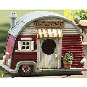 Give your backyard fowl a foul weather trailer home. This kitschy trailer birdhouse has retro style and practical appeal. Birds fly into the front door of this welcoming shelter. The painted resin home includes a pullout drawer for cleaning.