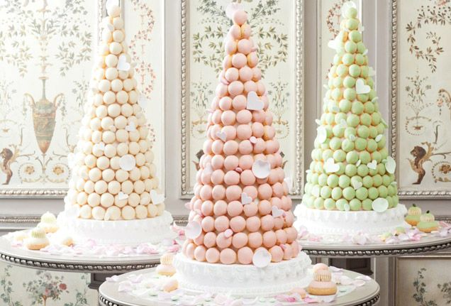 The croquembouche is the quintessential French wedding cake, a towering confection of cream-filled puff pastry. The three pastel towers shown here were made by Ladurée. @Four Seasons Bridal