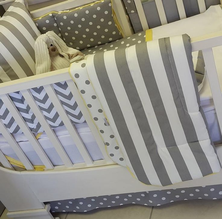 Beautiful reversible Cot Quilt with Stripe one side and Polka Dots on the reverse.