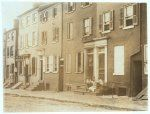 Group of children playing on the stoop of a house next to 229 Tatnall St., a reputed house of prostitution. Investigator, Edward F. Brown. Location: Wilmington, Delaware / Photo by Louis W. Hine, May, 1910. | Library of Congress