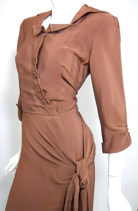 """Cinnamon crepe rayon late 40s dress by Adele Simpson. Angled placket below origami folded collar, doughnut style self buttons. Hook and eye at waist, snaps within waist seam....hip boasts an elegant draped and knotted swag. Utterly flawless, click picture for more images.  36"""" bust, 26"""" waist, 38"""" hips, 46"""" long, 17"""" bodice, 20"""" sleeves    415  RESERVED"""