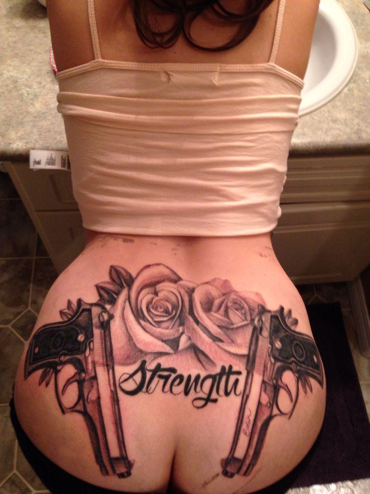 New ink . Tattoos . Gun Tattoo . Rose Tattoo . Guns and Roses Tattoo . Back tatty . Back Tattoo . Black and white tattoo . Tramp stamp .