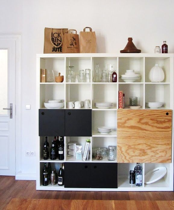"""Materials: Expedit, door hinges, black MDF, plywood (pine tree) Description: As we like a very """"open"""" style of kitchen where you can see at the end all the stuff that is part of this room we decided to buy an Expedit to store our plates and glasses etc.. But after assembling the rack and putting …"""