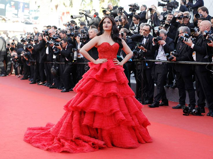 2017 Cannes: Aishwarya Rai is wearing a red Ralph & Russo ball gown with layered ruffles and intricate beading. I'm obsessed with this gown! She is stunning on the Cannes red carpet!