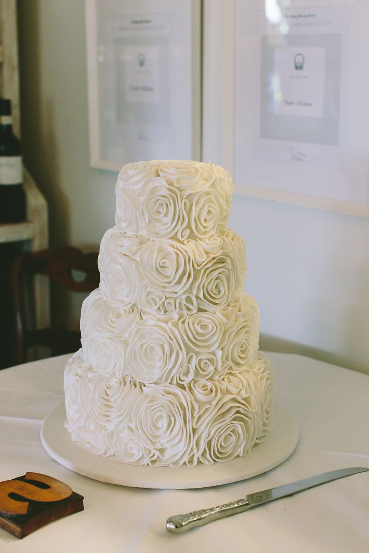 Icing flower covered wedding cake. Image: Cavanagh Photography http://cavanaghphotography.com.au
