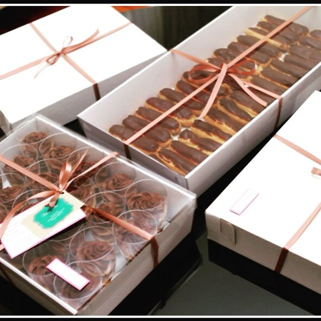 Sri Lankan Finger Food boxes... Fish Rolls, Fish Patties, Chocolate Éclairs and Chocolate Biscuit Pudding..