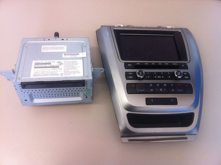 2010 FUSION MILAN HYBRID RADIO GPS INFO SCREEN NAVIGATION HEATER CONTROL BEZEL