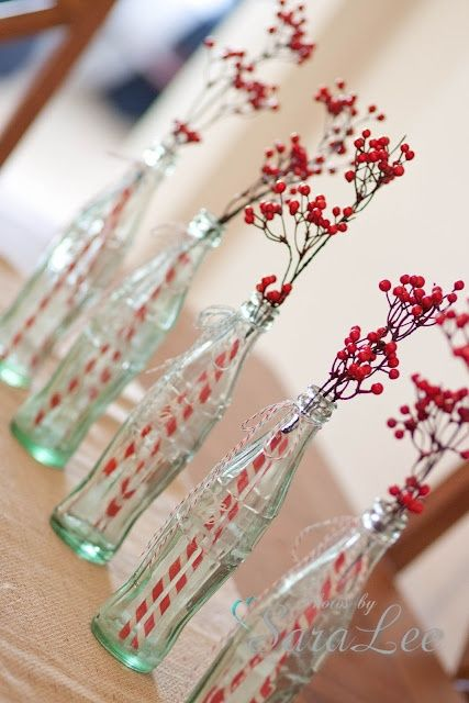 Something Different Monday's Simple Coca-Cola bottle centerpieces. *Tip - use a colorful straw to cover the stems!