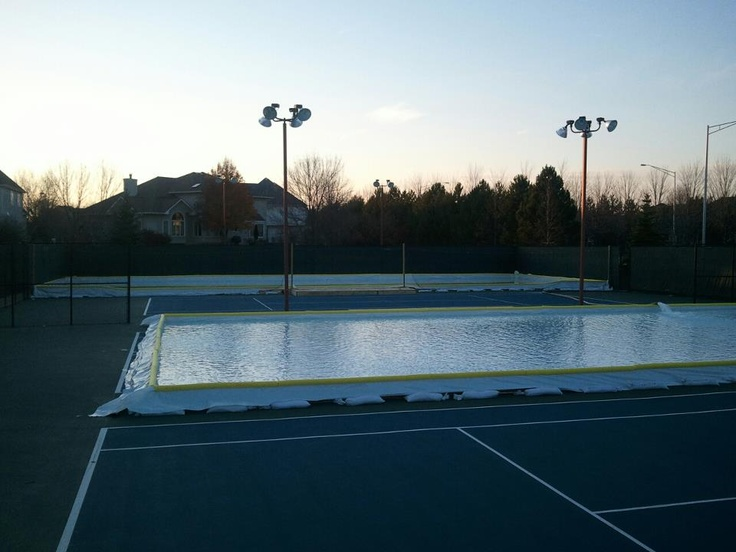 Backyard ice rink on a tennis court backyard ice rinks for Homemade basketball court