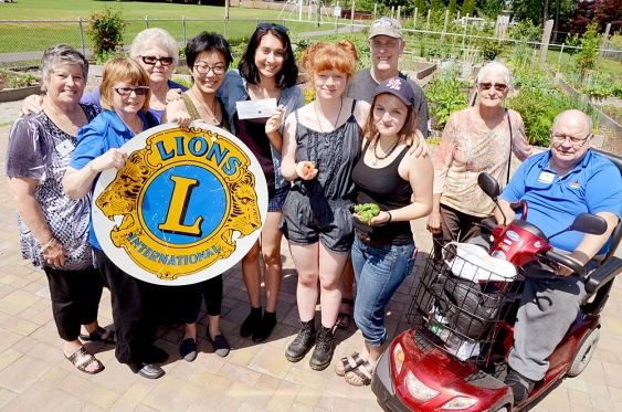 Fort Langley Lions give donation to a student greenhouse.