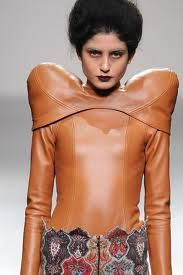 Those are either some crazy shoulder pads or plastic surgery gone horribly wrong!
