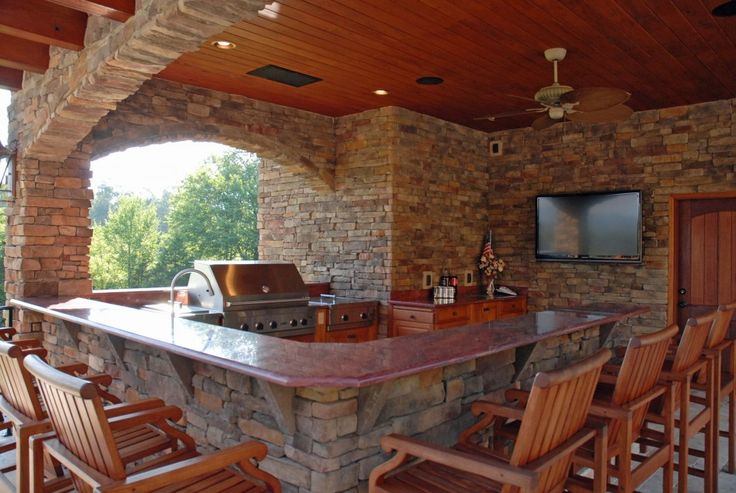 Outdoor Kitchen Ideas With Rustic Wooden Counter Kitchen Islands With Seating And Range Over Stacked Stone Wall Expose Wooden Plank Roof Recessed Lighting Wooden Kitchen Cabinet