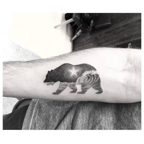 Double exposure bear tattoo on the right inner forearm. Tattoo...