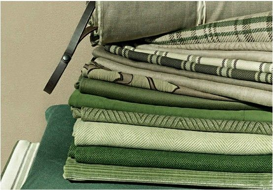 The Loro Piana Interiors collection for country homes offers fabrics inspired by nature. Solid colors, stripes, chevron patterns and checks are worked in a color palette where ecru and neutrals blend with browns and greens. Available at Co van der Horst.