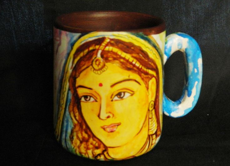 These hand painted terracotta mugs adds charm to your beautiful living space. This art form is unique in every form.