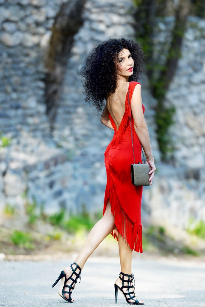 Flying in a SPINE red dress by Dana Budeanu - Simonity