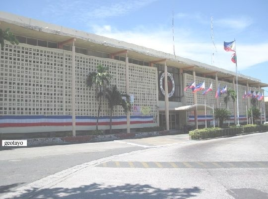 """Cavite City Hall - Located in pre- World War ll site of Dreamland Cabaret and the """"Pantalan de Yangco,"""" this imposing building sits on one end of the City Park. Paseo de Barangay is located at the back of City Hall."""