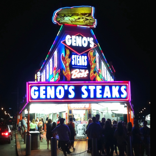 Geno's Steaks | Geno's boasts the best cheesesteaks in Philadelphia since 1966 but we'll let you be the judge. Located within eyesight of Pat's King of Steaks, this 24 hour shop is known for their Wiz Cheesesteak Sandwich.