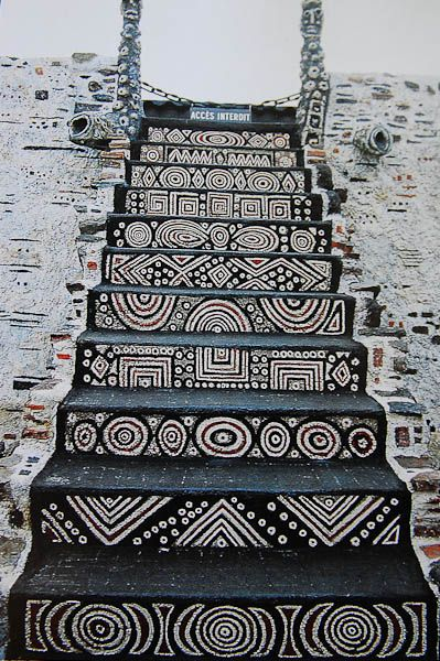 stairway with fantastic brown and white African tribal designs...Musee Robert Tatin