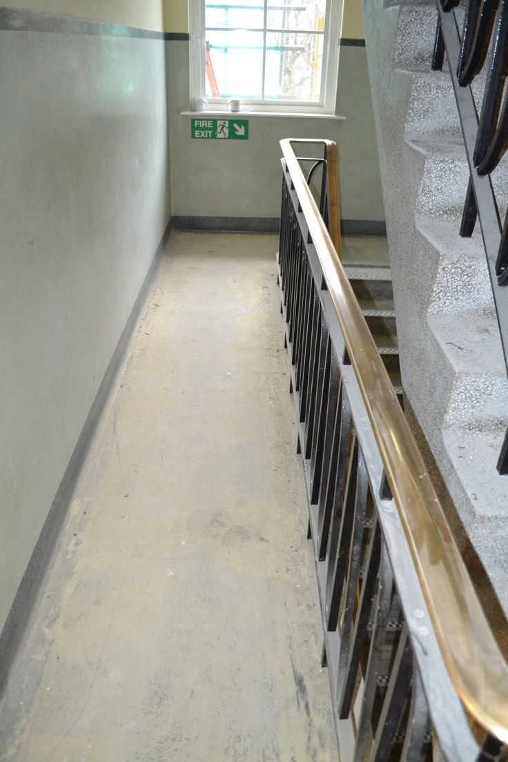 Terrazzo stair landing before restoration cleaning polishing and sealing.
