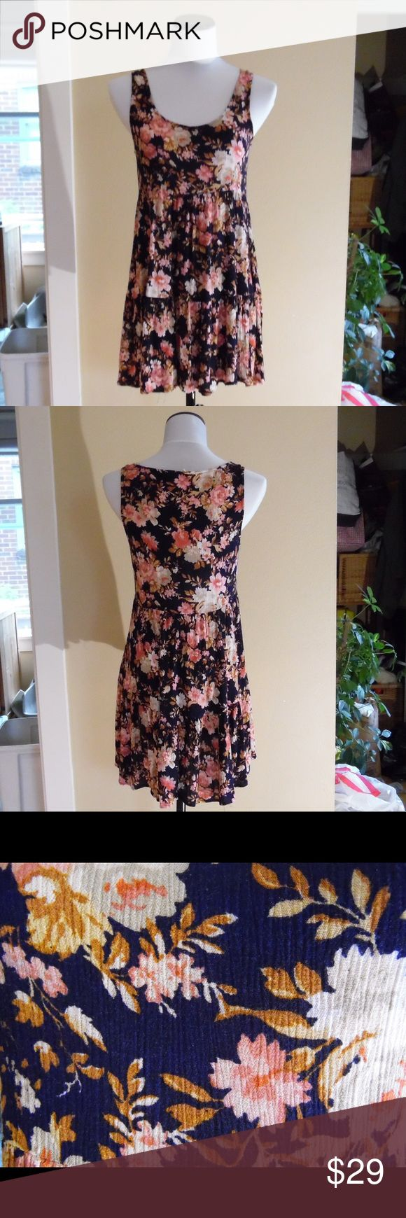 American eagle outfitters floral babydoll dress. Pretty baby doll dress from American Eagle outfitters. Worn a few times. Looks and feels new. Pretty pattern and nice colors. Really nice texture. American Eagle Outfitters Dresses Midi