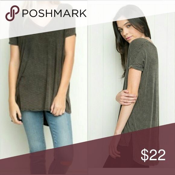 Brandy Melville Milan striped oversized V neck t READ: ONE SIZE!! Super soft black/brown striped vneck, in a textured fabric (almost subtly distressed). Oversized fit. Worn and washed 5 times or less. I'm offering 30% off 3+ bundle which will reduce this item by more than $6. In addition, the first person to spend $50 or more will get a Brandy henley for FREE! Brandy Melville Tops