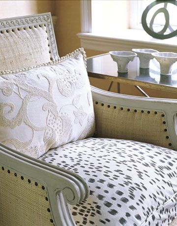 Use Modern Upholstery on Traditional Furniture. I did this for a client in Atlanta, covering his wingback chairs in an earth-tone & white polka-dot pattern to compliment a white sofa.
