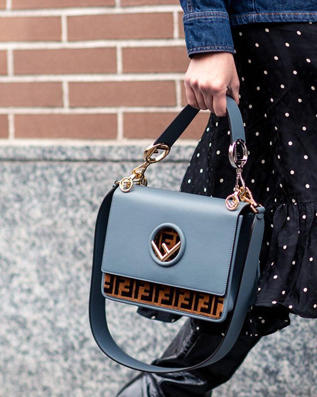 69ffd7038f83 Spotted at #MFW – the @fendi Kan I logo-print handbag. The FF logo motif  and elegant blue-grey shade score serious #style points.