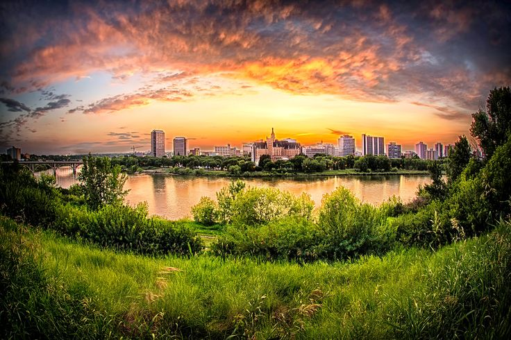Sunset over the city of Saskatoon. I shot this with a fish-eye lens to give the unique perspective of the cityscape.