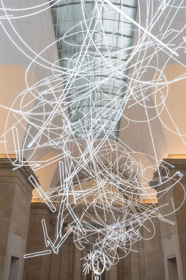 Tate Cerith Wyn Evans installation - Almost two kilometres of neon lighting shaped into sharp lines and sweeping forms create this installation by Welsh artist Cerith Wyn Evans, which is suspended in the Tate Britain's Duveen Galleries.
