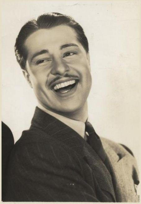 "Don Ameche, 1930's (1908-1993).  American actor born in Wisconsin who had a career spanning almost sixty years. After touring in vaudeville, he was featured in many biographical films, including ""The Story of Alexander Graham Bell"" (1939). He appeared on Broadway, as well as on radio and TV. He was host and commentator for ""International Showtime"", covering circus and ice-shows all over Europe. Ameche was married to his wife Honore for fifty-four years, and they had six children. (Wikipedia)"
