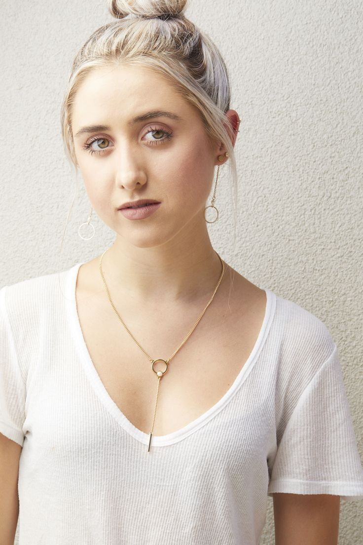 Minimal jewelry pieces featuring clean lines and geometric shapes with pearl accents. Eclipse Necklace in gold and Grace Earrings in gold.  #canadianjewelry #hoopearrings #foxyoriginals #simplestyle #fashion