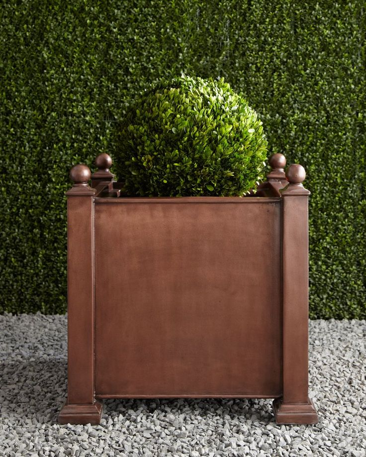 Depending on how they are displayed, plants can add a dose of luxe to a patio. This antique planter ($495) is a great option for flowers or greenery and will age well with time.