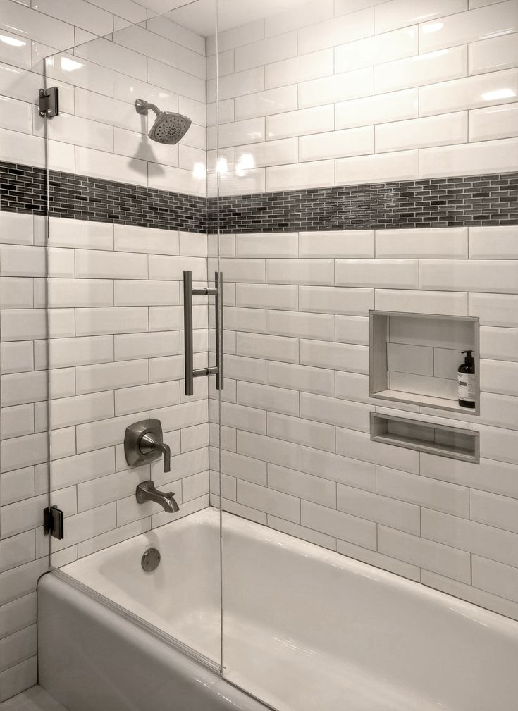 A Stunning Tub Surround With White Beveled Subway Tile