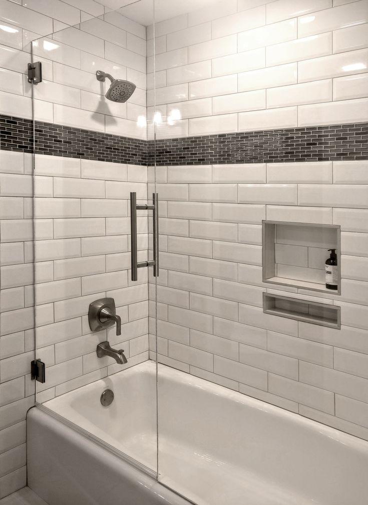A Stunning Tub Surround With White Beveled Subway Tile