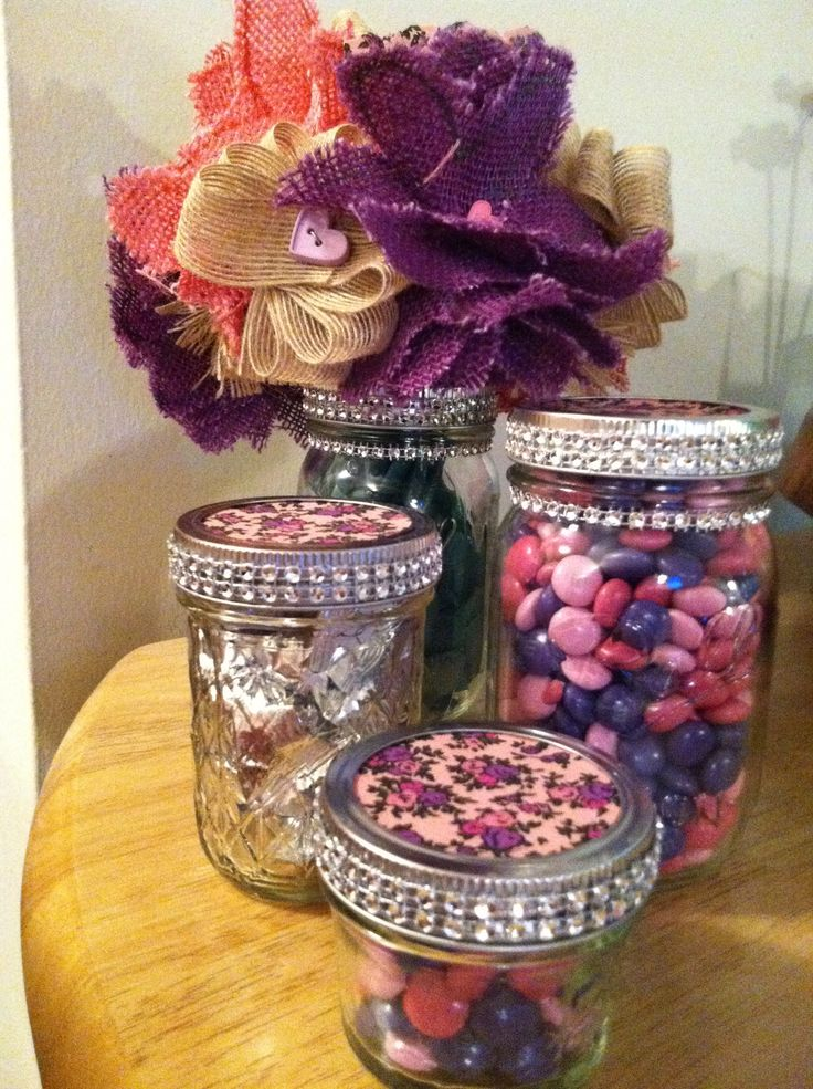 Decorated fabric covered mason jars - glue fabric to the lid and then glue to the rim.  I also added very inexpensive bling I bought at Michael's.  I used the 4 oz jars with M&Ms as favors at my sister's bridal shower.