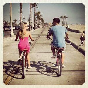 Jesse and Jeana are bike riding in Venice Beach.