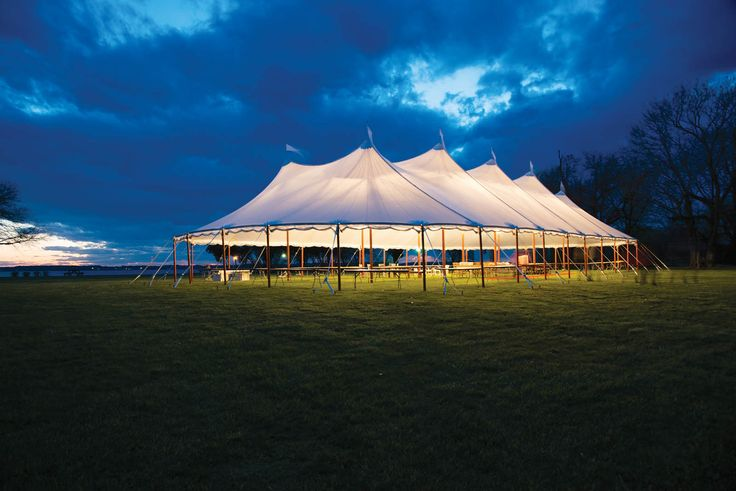 The translucent fabric of Anchor's Aurora sheer-top tent combines with dramatic up-lighting for an appealing glow to nighttime events. Photo courtesy of Bailey's Party Rentals, Leonardtown, Md., and Anchor Industries.